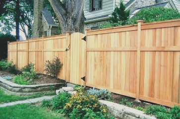 beautiful-fence-stained-natural-wood-stain-and-a-gate-in-the-backyard-of-a-home